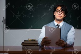 115000077-young-math-teacher-in-front-of-chalkboard